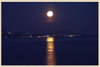 moon setting over lake geneva