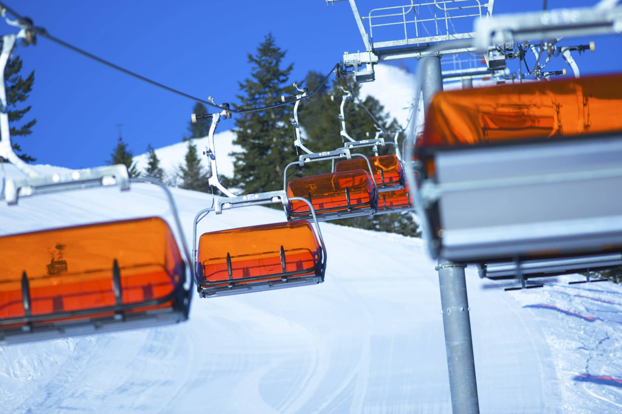 The Orange Bubble Express heated chairlift keeps skiers cozy en route to the runs. Photo: Rob Bossi, Canyons Resort.