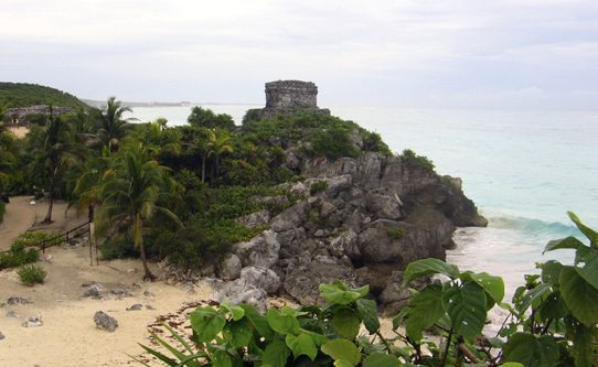 Tulum's Mayan ruins perch atop a dramatic oceanfront cliff.